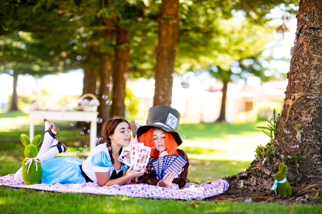 Alice and Madhatter at the park for an event
