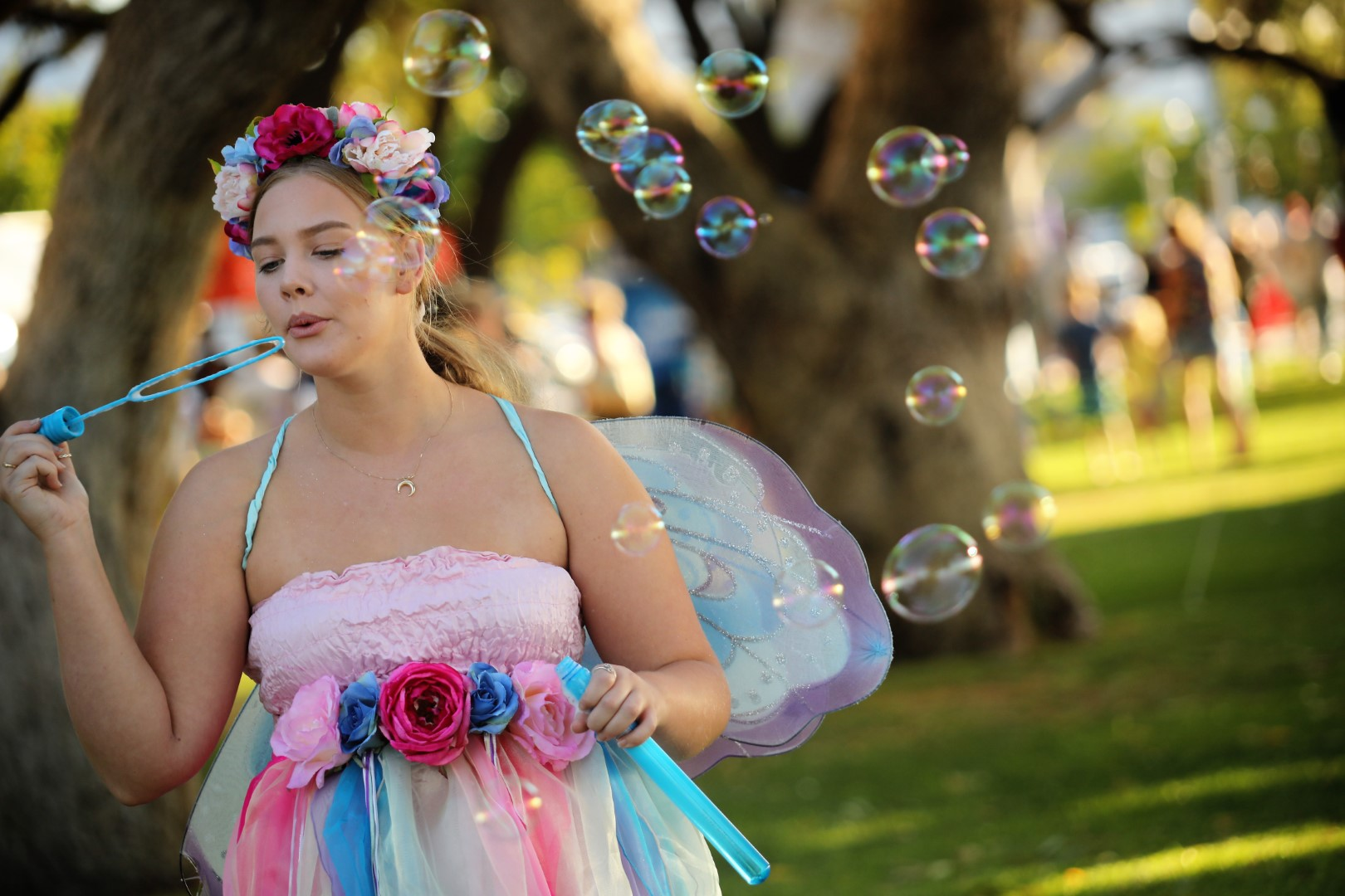 Young lady blowing bubbles for an event