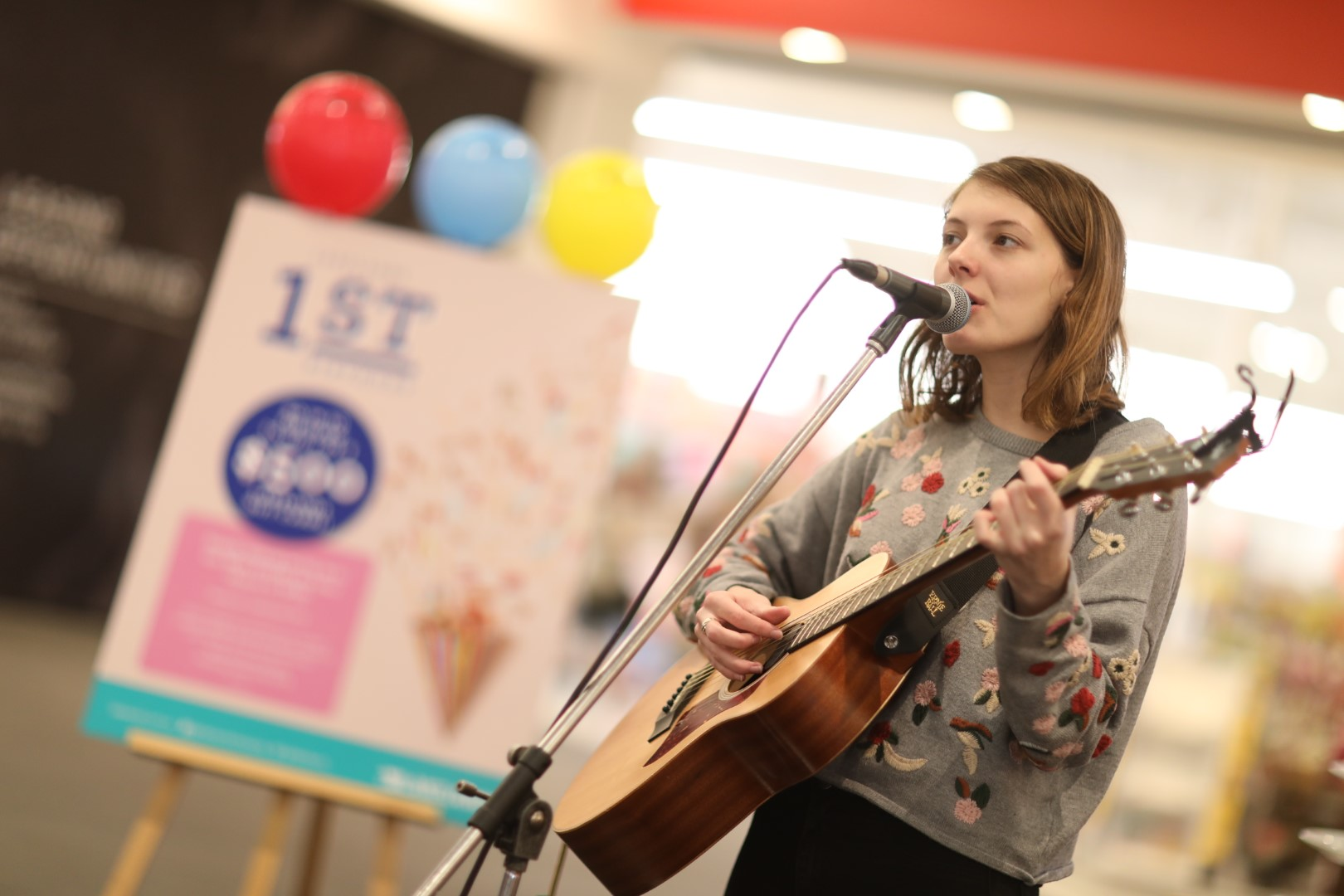 Young lady performing inside a shopping centre.